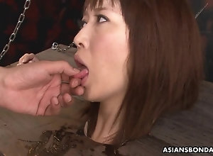 Restrained Asian sandy-haired gasps and drools on the hard cock