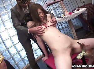 Masked guys have adventures with doomed up Asian's sensitive nipples