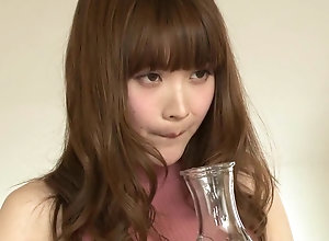 Japanese female drinks her friends saliva