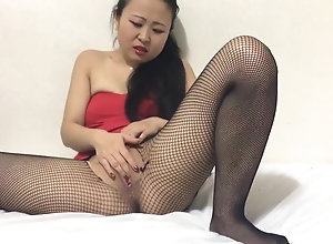 Sexy Asian female in pantyhose