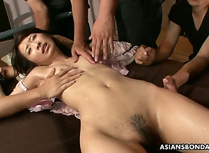 Bunch of dudes stimulates restrained Asian's skinny bod and