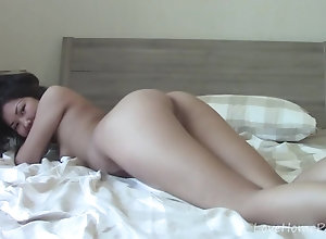 Naughty Asian spreads her gams and masturbates passionately